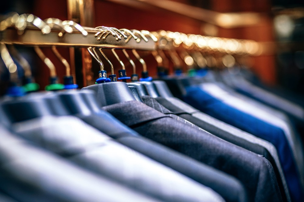 Blazer Jackets on Rack - Arts & Entertainment Like Save Row of men suit jackets on hangers.