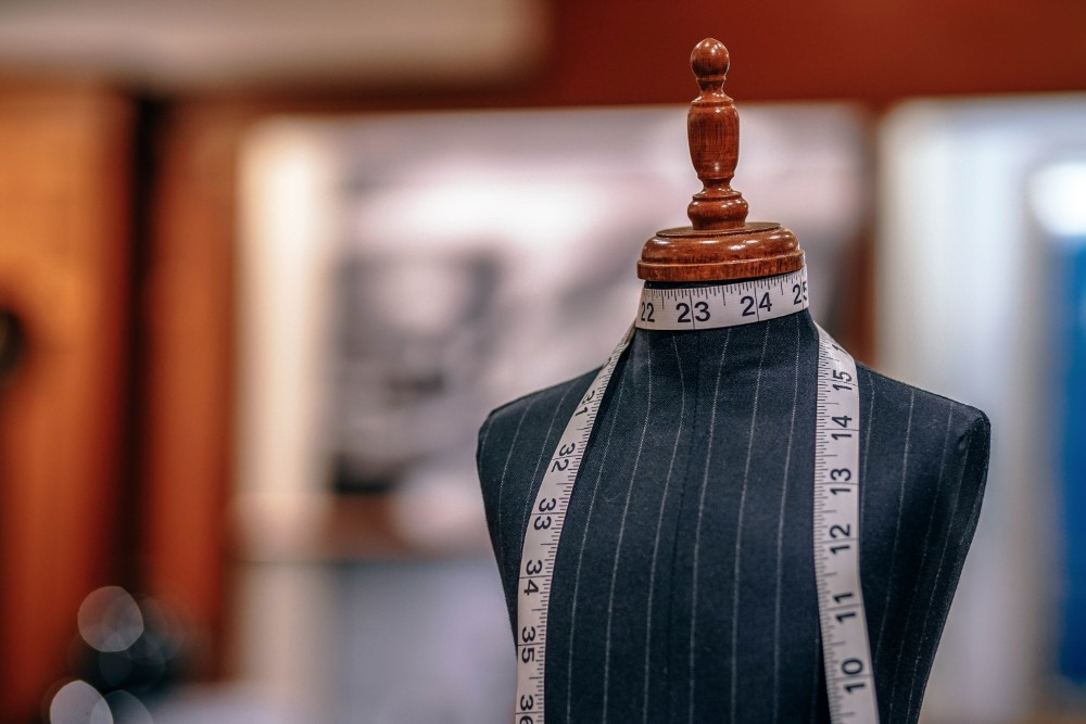 Custom Tailor - Beauty & Fashion Like Save Tailor measuring for client.