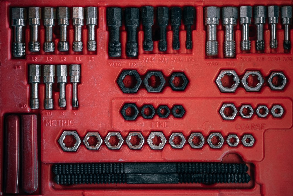 Red toolbox inside an automobile repair garage.