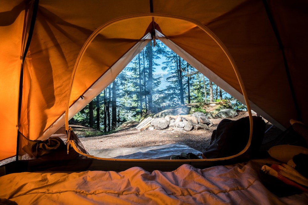 Waking up inside a tent during a camping trip