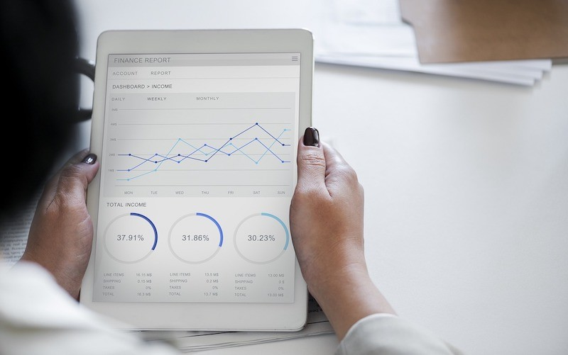 Woman-Looking-at-a-Financial-Report