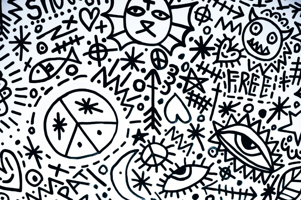Black and White Doodle Art with Peace Symbols