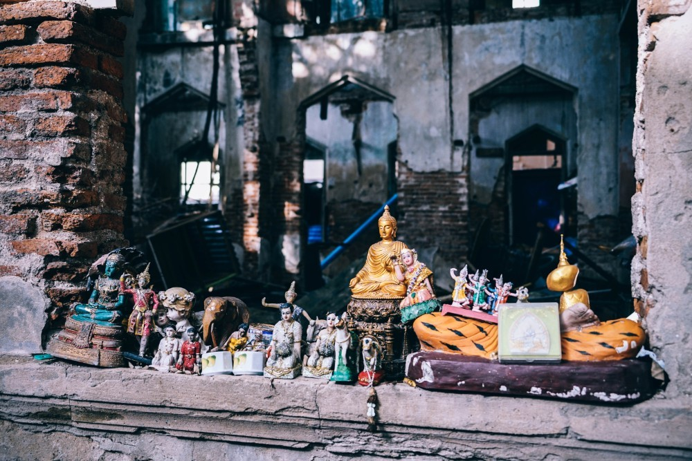 Buddhist Statues inside an Abandoned Building