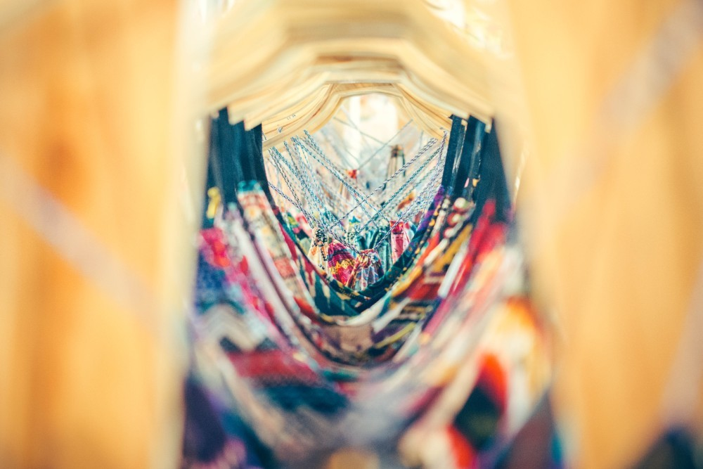 Close Up Photography of Colorful Dresses Hanging