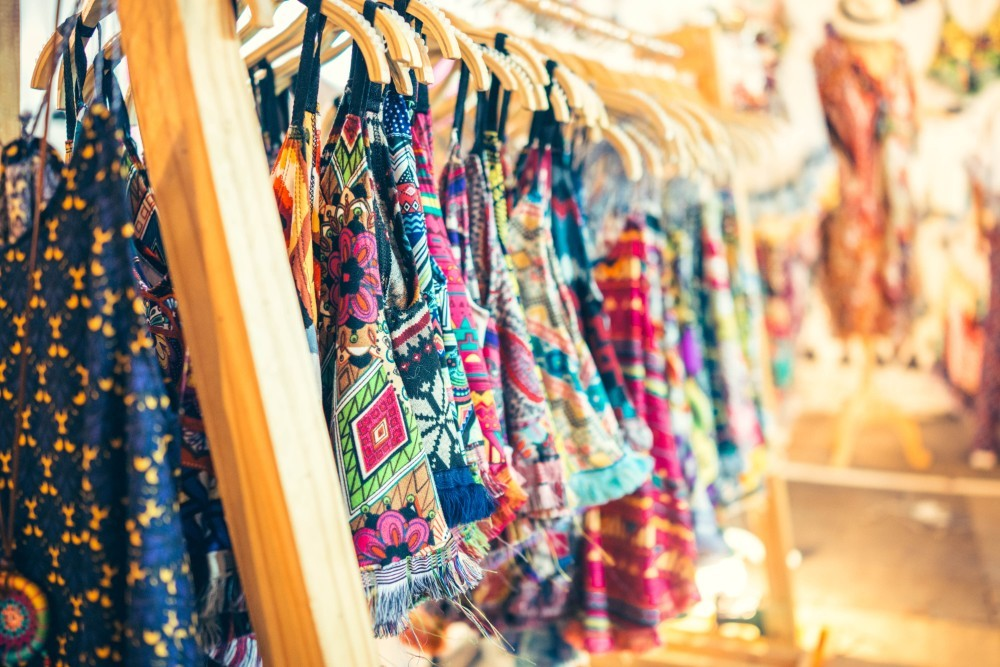 Colorful Dresses and Shirts Hanging on Hangers