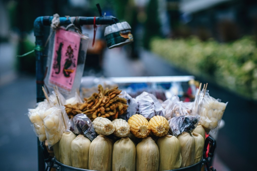 Street vendor selling different kinds of corn
