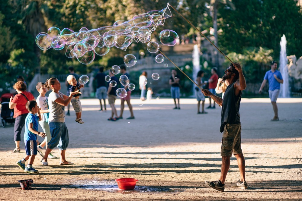 Man-Blowing-Soap-Bubbles-in-the-Barcelona-Park