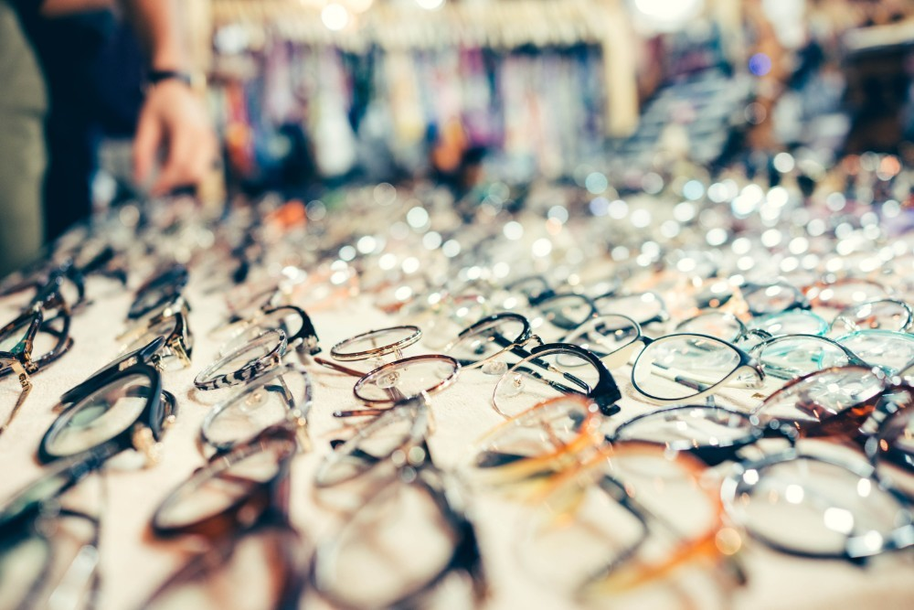 Many Different Eyeglasses Presented on a White Sheet for Sale