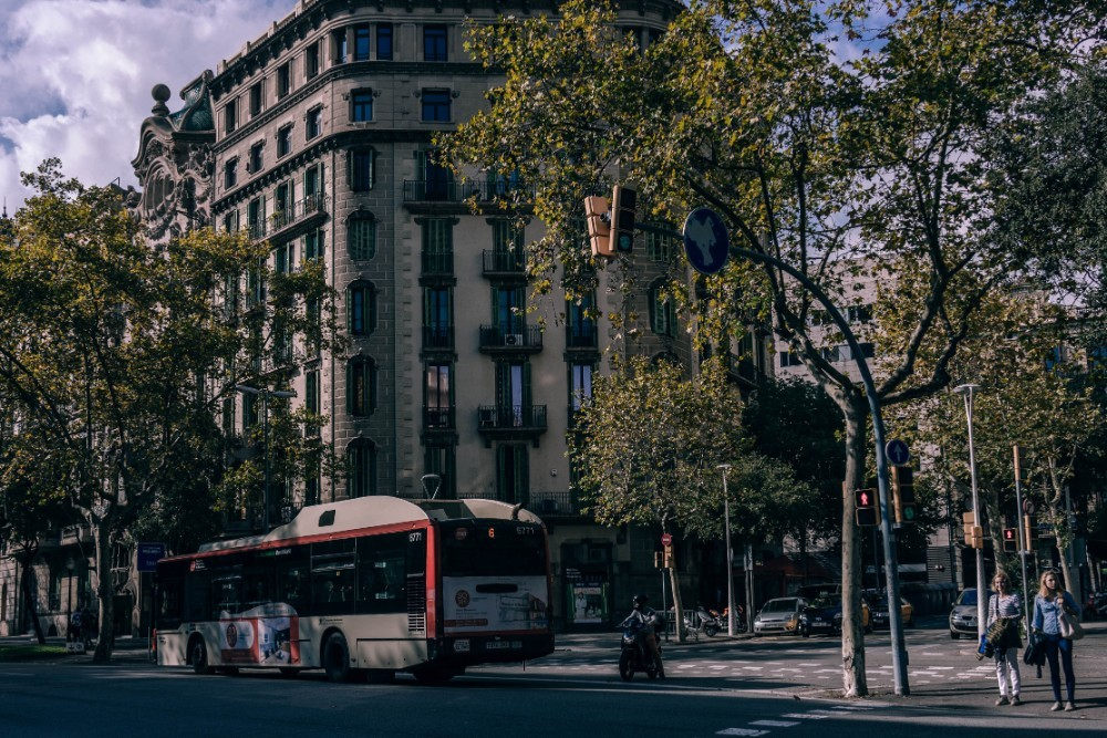 Public Bus and a Motorbike on the Streets of Barcelona
