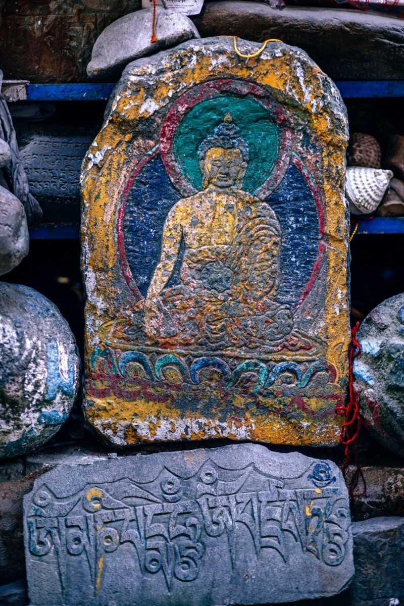 Colorful Buddha Carving on a Stone