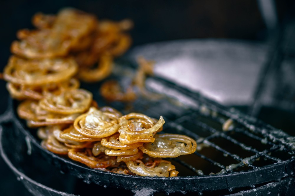 Indian Sweet Jalebi Drying on a Rack