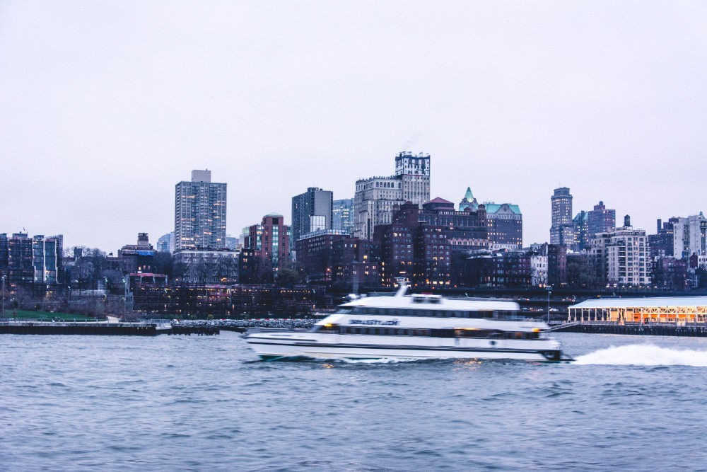 Speedboat-Driving-on-the-East-River-with-Beautiful-Buildings-in-the-Background
