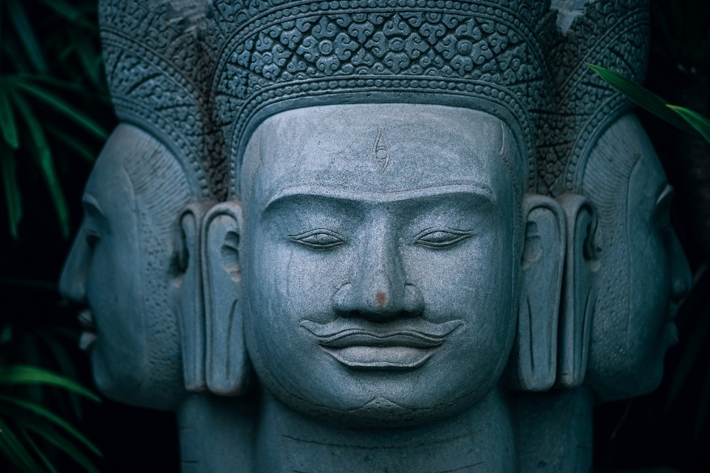Three-Headed-Buddha-Statue-inside-a-Zen-Garden-in-Cambodia
