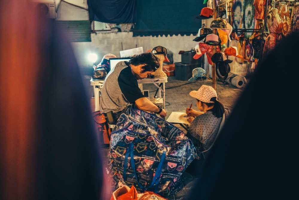 A Man and a Woman Drawing at the Night Market in Chiang Mai