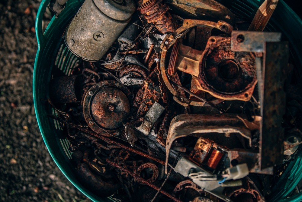 Basket-Full-of-Old-Metal-Parts-Photographed-from-Above