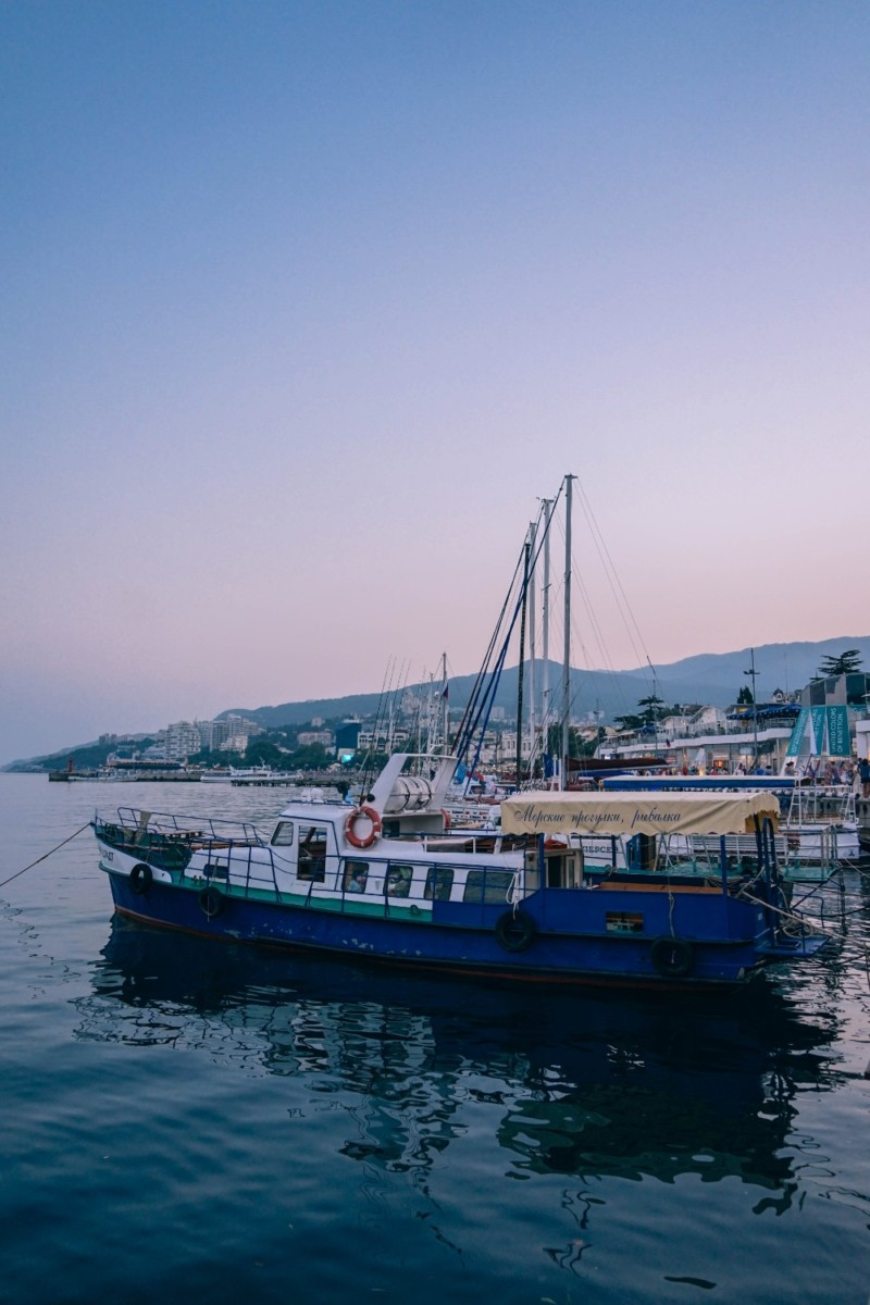 Blue-and-White-Boat-during-Sunset-in-Yalta