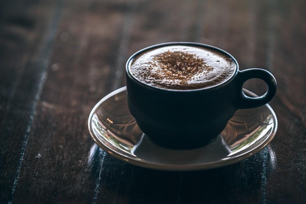 Close-up Shot of Coffee inside a Black Mug