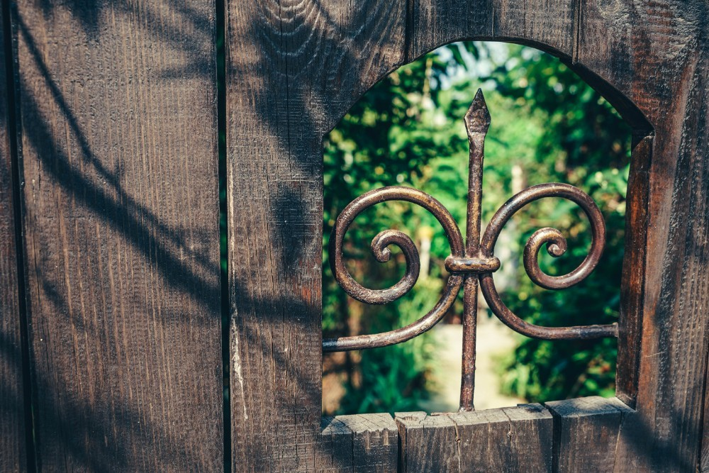 Close-up-Shot-of-an-Opening-in-a-Wooden-Gate