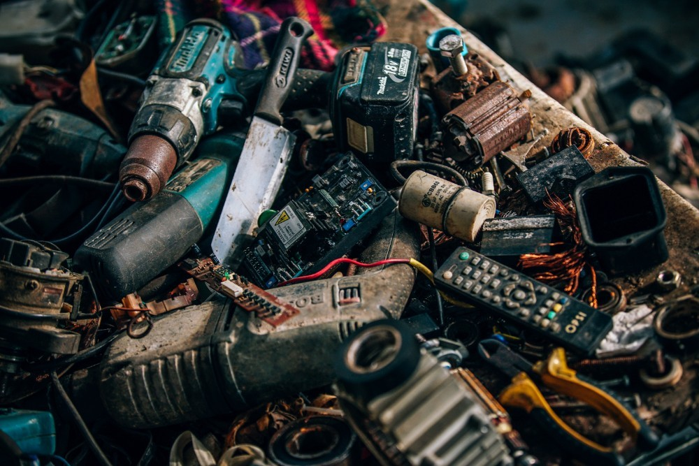Different Types of Batteries and Tools Piled Up on a Table