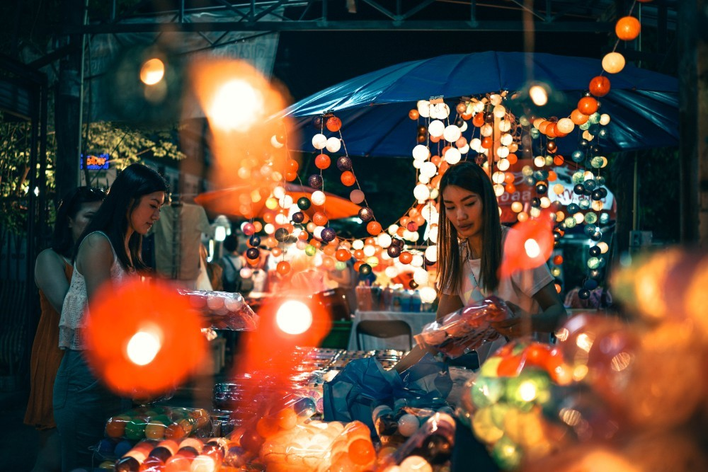 Girls Sorting Out Products at the Night Market in Chiang Mai