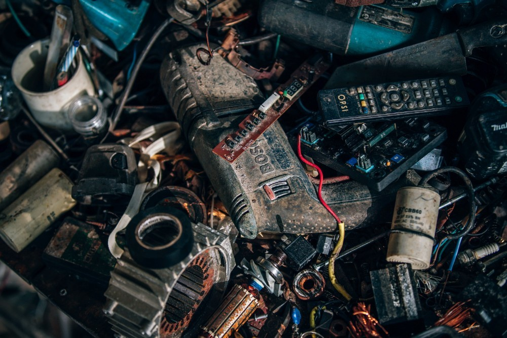 Messy Power Tools, Batteries, and Remote Controllers on a Table