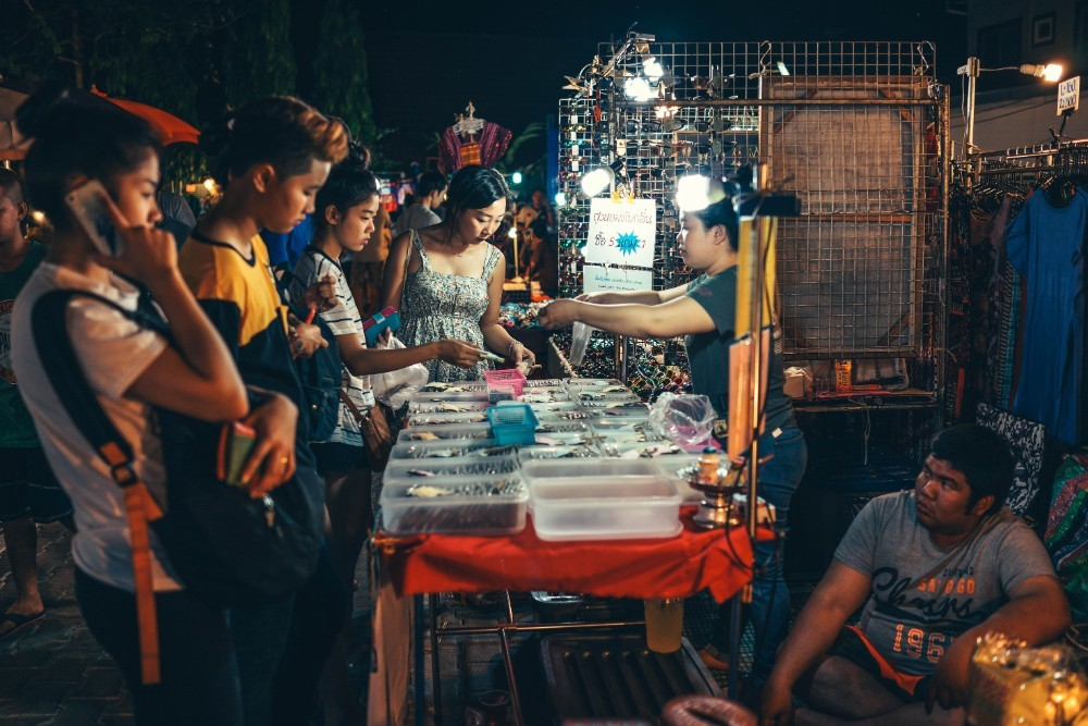 People Checking Out Handmade Jewelry at the Chiang Mai Night Market