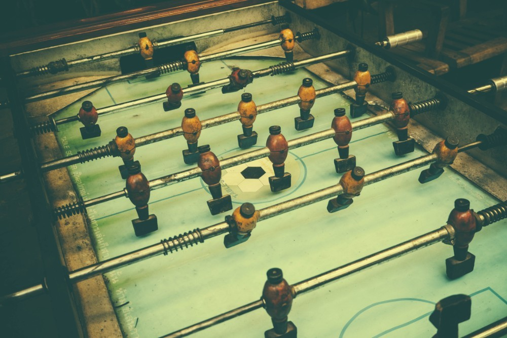 Vintage-Foosball-Table-with-Yellow-and-Red-Players