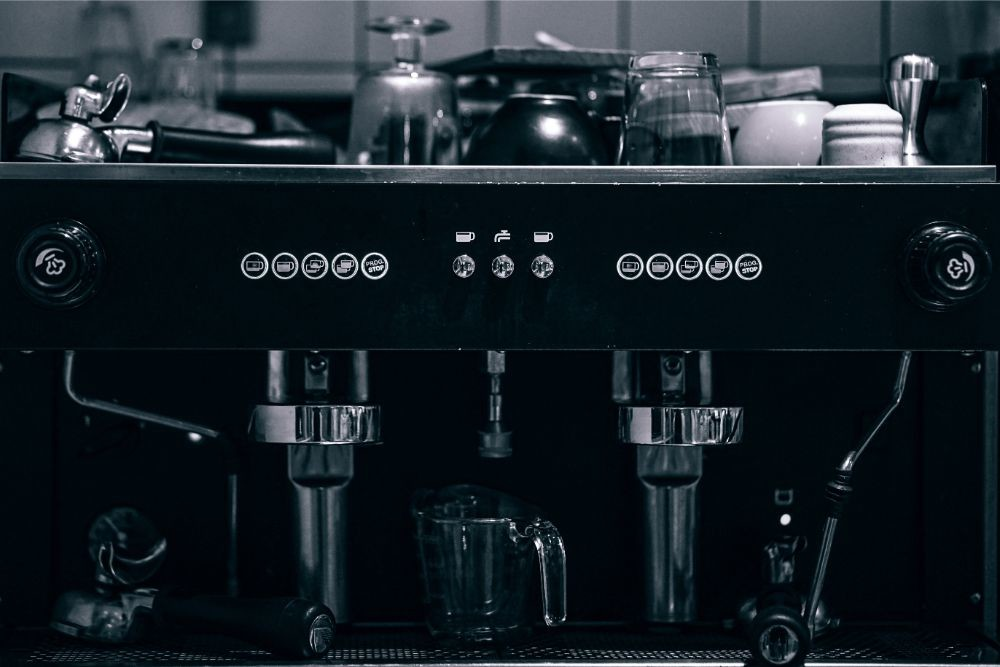 Black and White Photography of a Coffee Machine