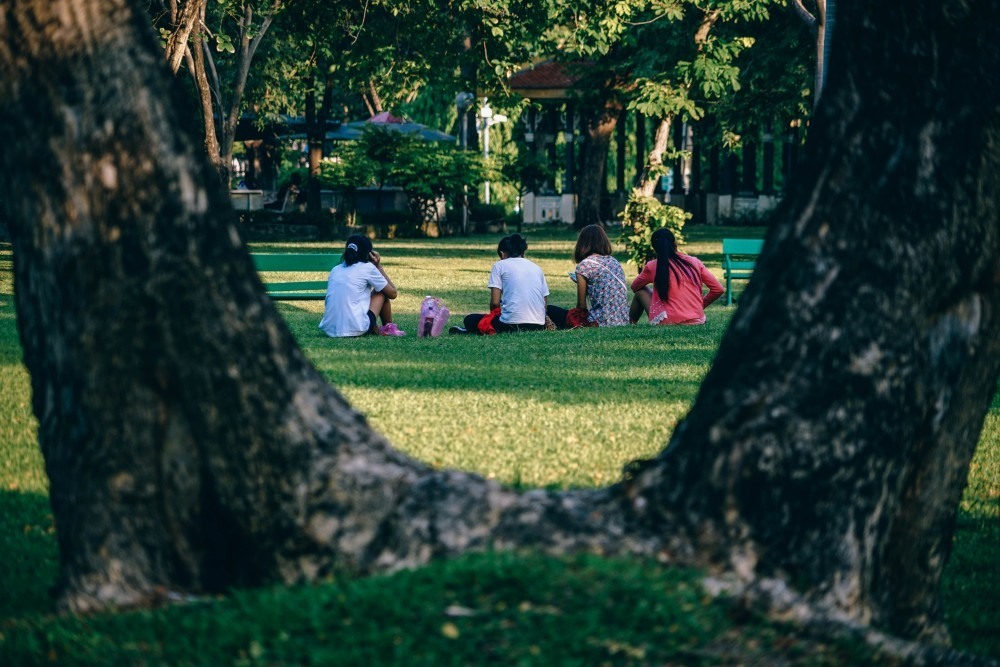 Friends-Sitting-on-the-Freshly-Cut-Grass-in-Lumphini-Park