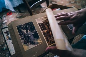 Hands Flipping a Page on an Old Family Album