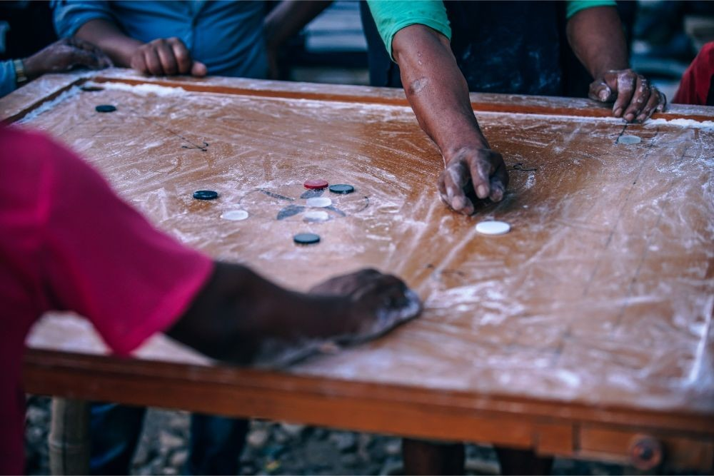 Nepali-Man-Playing-a-Board-Game