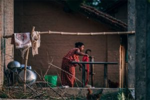 Nepali Woman Washing Her Clothes