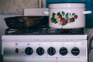 Pan and a Pot on a Gas Stove