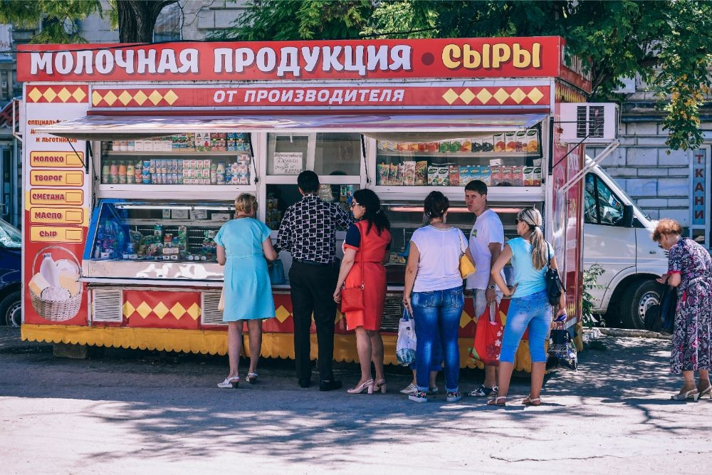 People Waiting in Line at a Street Food Stand