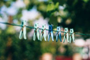 Plastic Clothes Pegs on a Clothesline