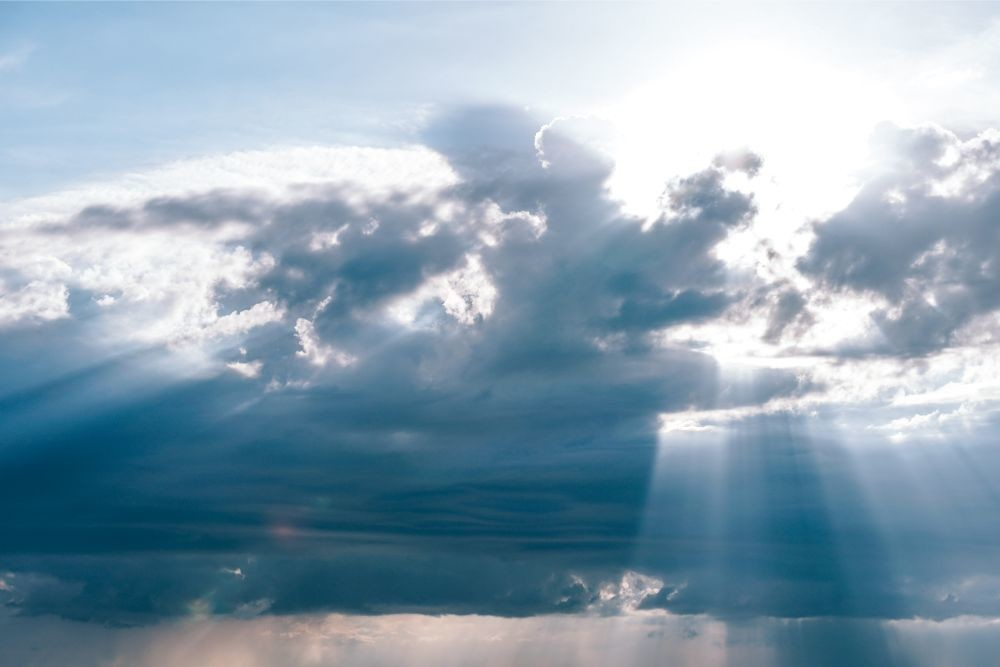 Rays-of-Sunshine-Passing-Through-Fluffy-Clouds