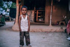 Small Village Boy Posing for a Photograph