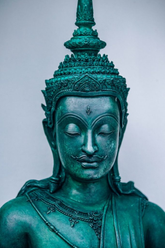 Teal Buddhist Warrior Statue with a Mustache