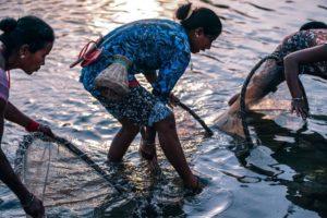 Three Women Fishing at Dusk