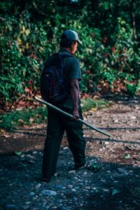 Tour Guide Walking on a Dirt Road