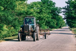 Tractor Driving Through a Russian Country Side Road