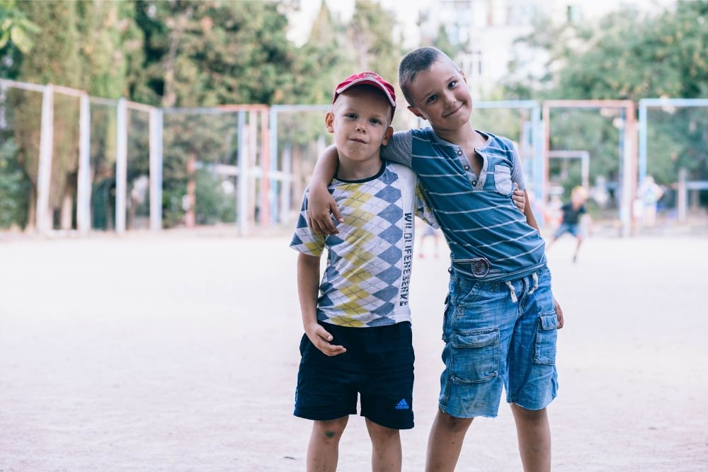 Two Kids Hugging and Posing at a Soccer Field in Sevastopol