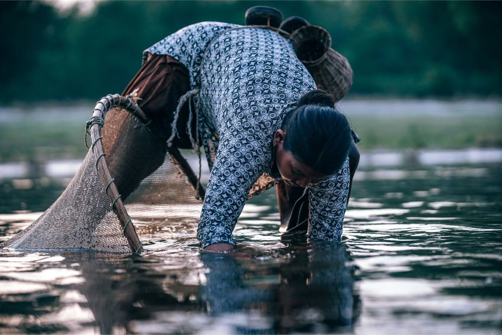 Woman-Fishing-By-Hands