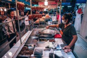 Woman Preparing Pork for Customers at the Phantip Night Market
