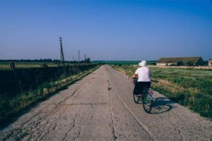 Woman Riding a Bike in a Russian Country Side