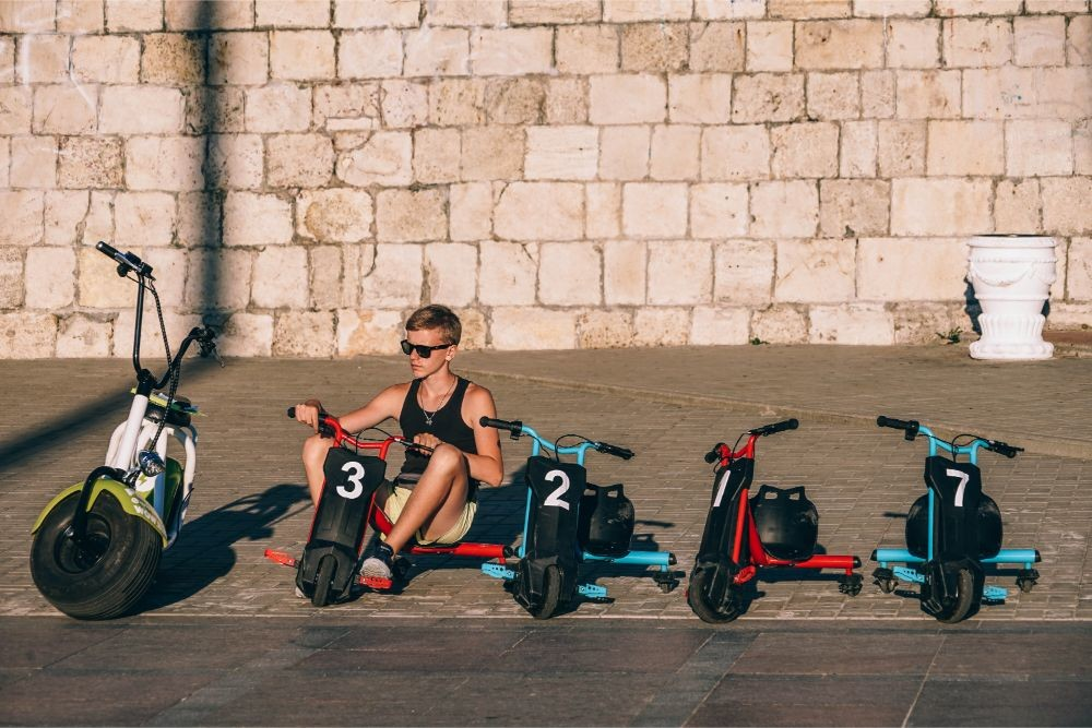 Young-Man-Sitting-on-a-Scooter-on-the-Streets-of-Sevastopol