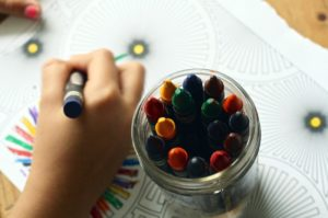 hand coloring a coloring book