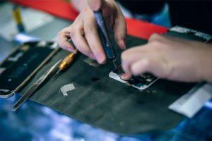 Woman Repairing a Smartphone