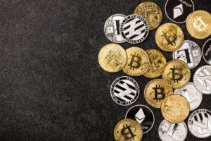 bitcoin ethereum litecoin coins on black UMNEQ