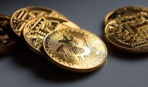 bitcoins on grey background PMZZPBK